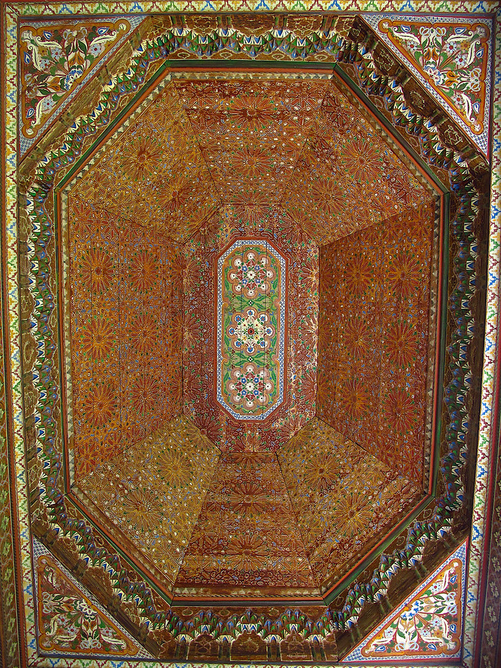 All of the ceiling artwork is hand painted on cedar.