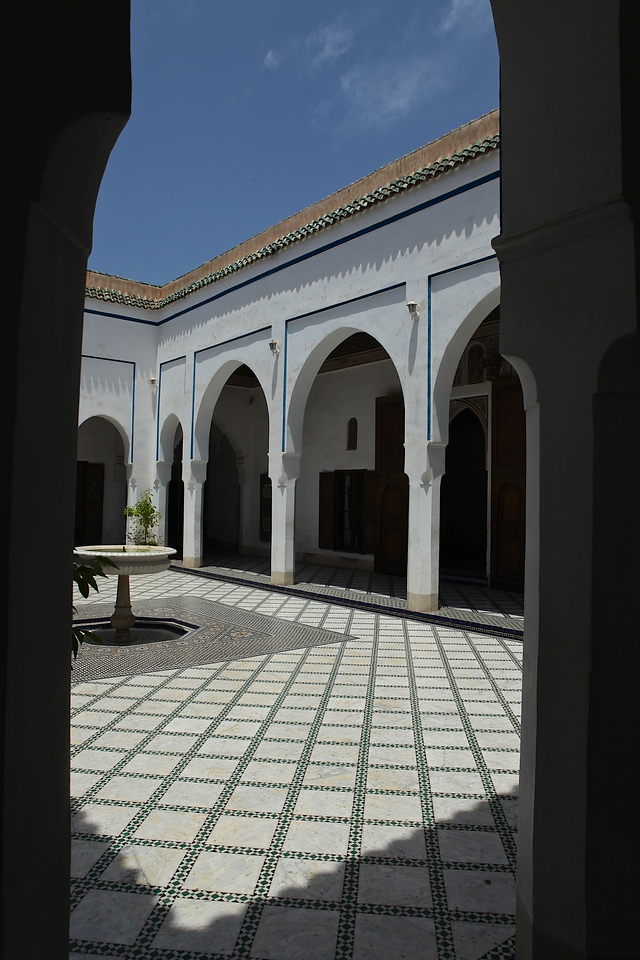 One of the finest elements of the Bahia Palace is the grand marble-paved courtyard, constructed between 1896 and 1897.  It is divided into quadrants by paths of multicolored zellige, or enameled terracotta tiles, in a simple checkered pattern. Each quadrant is paved in white marble with thin borders of zellige between each large marble tile.