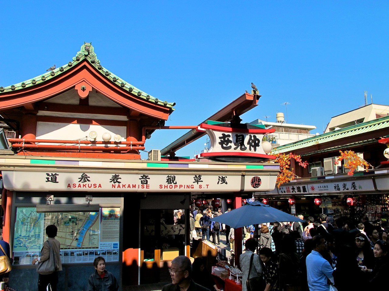 Between the gate and the temple, is the Nakamise shopping street.