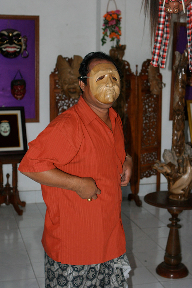 Mr Mauka demonstrates one of his masks.